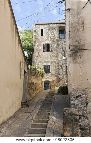 Narrow Street With Staircase In An Old Village In Southern Europe
