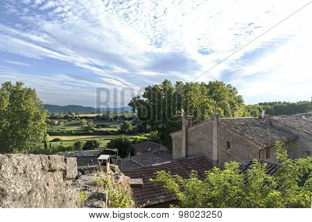 View Over The Roofs Of A Small Village Into The Landscape Of Provence