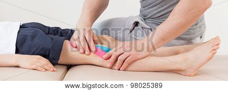 Patient With Kinesiology Tapes