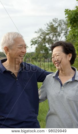 Asian Senior Couple Happy Together With Green Natural Background