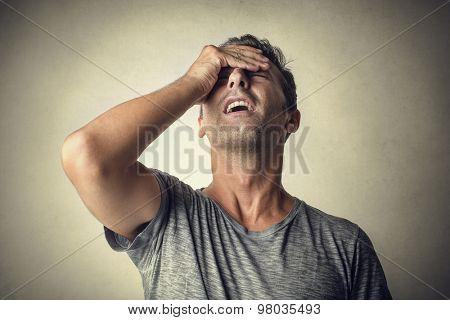 Man regretting something