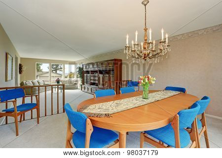 Modern Dinning Room With Royal Blue Chairs.