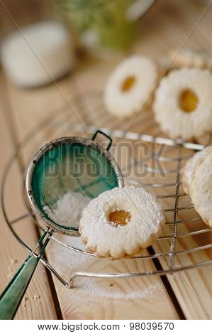 Linz Biscuit With Peach Marmalade With A Glass Of Milk In The Background
