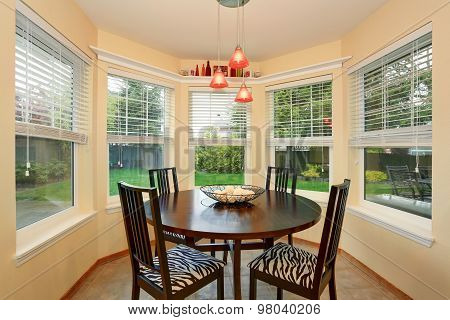 Nice Dinning Area With Many Windows.