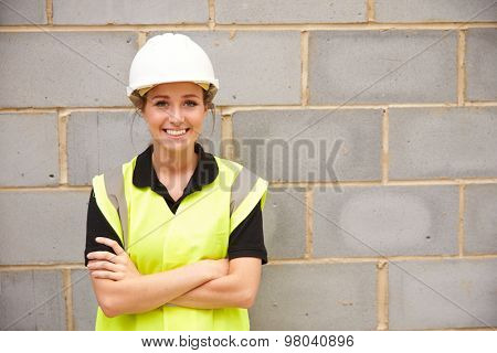 Portrait Of Female Construction Worker On Building Site