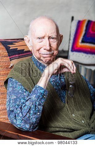 Elder Gentleman In Livingroom