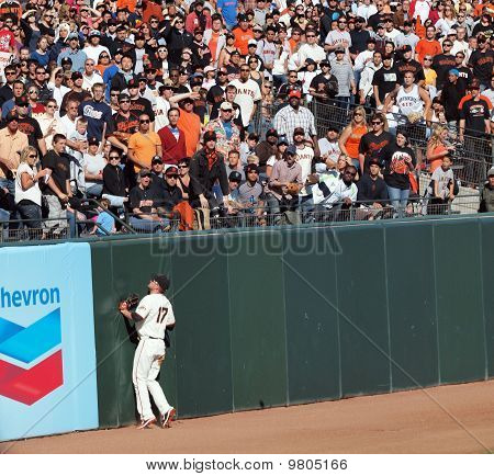 Aubrey Huff Presses Into The Wall As He Watches A Home Run Fly Over His Head