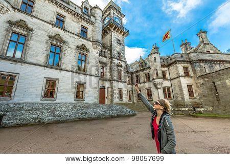 Tourist photographs Dunrobin Castle