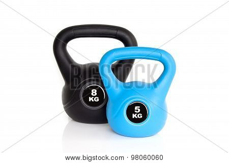 Black And Blue Kettlebells On White Background