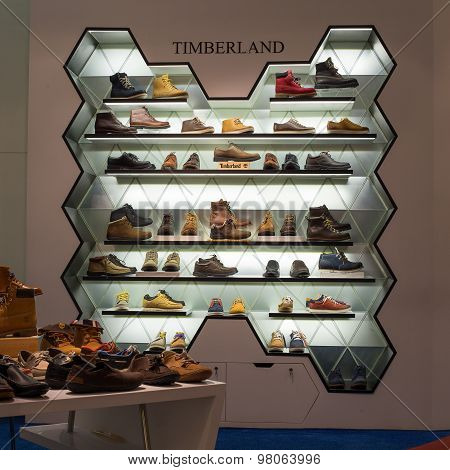 Lot shoes brand name - Timberland on a glass shelf at the Siam Paragon Mall. Siam Paragon is a one o