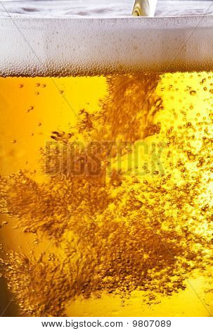 Pouring of beer.
