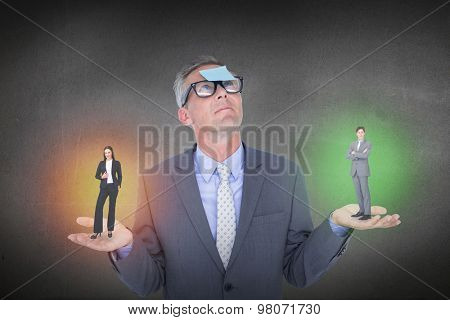 Assertive businessman standing against grey room