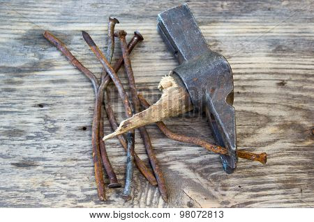 Old Curve Of The Nails And Nail Puller On A Wooden Background