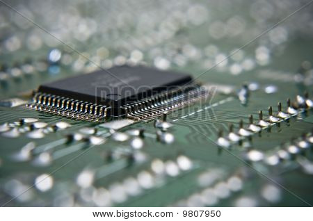 Microchip on green circuit board