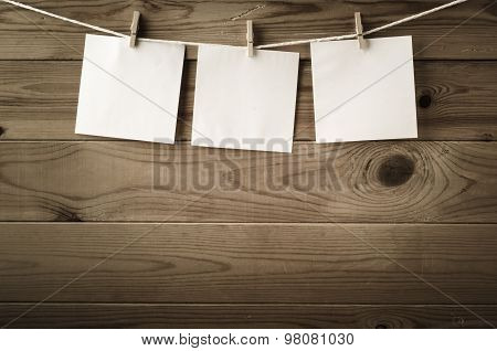 Three Square Reminder Notes Pegged On Clothesline