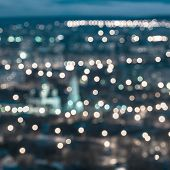 beautiful abstract blue circular bokeh background city lights with horizon and instagram style closeup poster