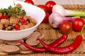 chili con carne with vegetables and beans in a white plate on a wooden stand macro poster