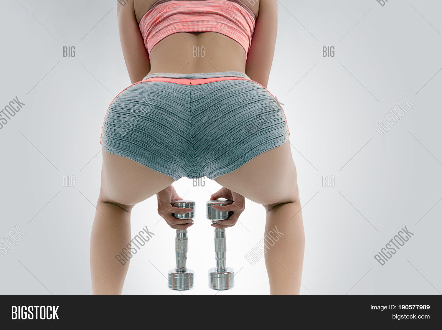 sexy ass. sportswoman dumbbells. image & photo | bigstock