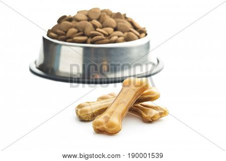 Dog chew bone and dry kibble dog food isolated on white background.