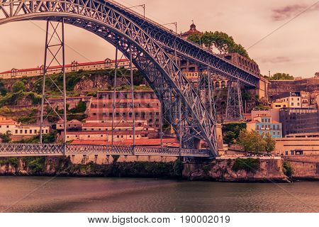 Porto, Portugal: the Dom Luis I Bridge and the Serra do Pilar Monastery on the Vila Nova de Gaia side at sunset