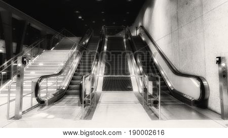 A empty escalator in black and white