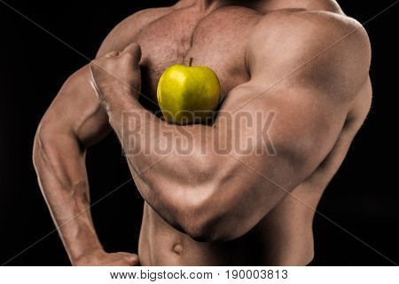 Partial View Of Shirtless Sportive Man With Apple On Arm Isolated On Black