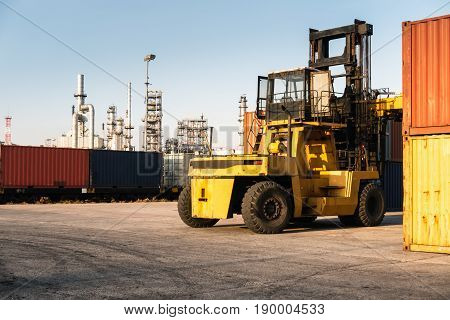 Forklift unloading and container stack in yard cargo shipping.