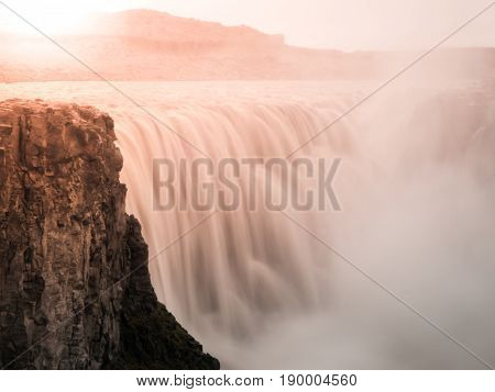 Detifoss waterfall illuminated by sunset, northern Iceland. Silk water effect by long exposure time.