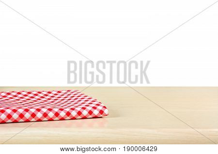 Red checkered cloth on wood table top in white background - can be used for display or montage your products