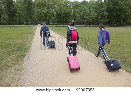 London United Kingdom 6 may 2017: tourists with trolleys in london hyde park