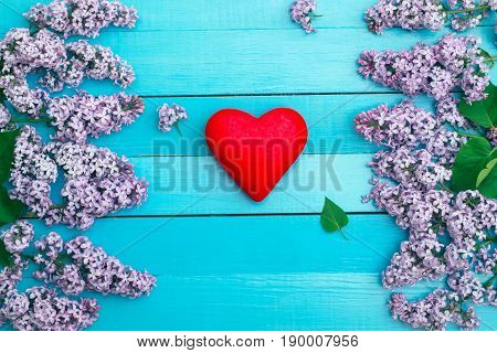 red heart against the background of with flowers