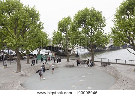 London United Kingdom 6 may 2017: boys play soccer near waterloo bridge in london on overcast day in spring in front of national theatre