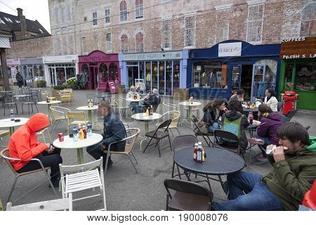 London United Kingdom 6 may 2017: people sit and eat at outside tables on outdoor cafe at The Warf in London on southbank of thames