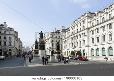London United Kingdom 6 may 2017: people stand and walk near statues of guards crimean war in london on waterloo place
