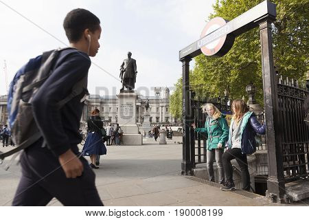 London United Kingdom 6 may 2017: girls at the exit of charing cross underground on trafalgar square near national gallery in london