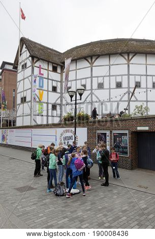 London United Kingdom 6 may 2017: group of teenagers stands in front of shakespeare's globe theatre on southbank of river thames in london