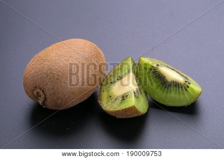 Kiwi Fruit And Kiwi Sliced On A Black Background