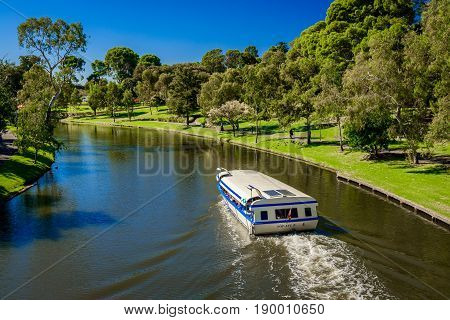 Adelaide Australia - April 14 2017: Iconic Pop-Eye boat traveling upstream Torrens river in Adelaide CBD on a bright day