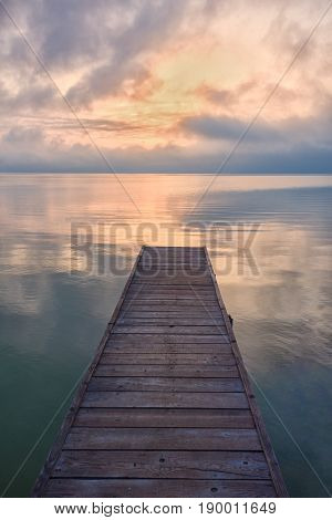 wooden pier in the sunset in summer