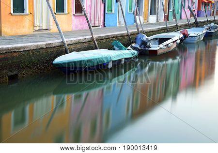 Burano Venice Italy. Many Boats Moored In Th Waterway And Long E