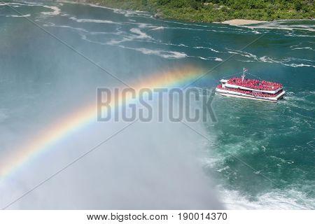 Rainbow at Niagara Falls and cruse ship, Ontario, Canada