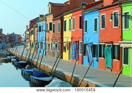Boats Moored In The Waterway Near The Colorful Houses Of The Isl