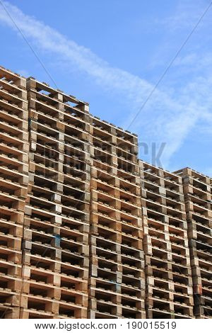 Piles of wooden pallets at a pallet storage