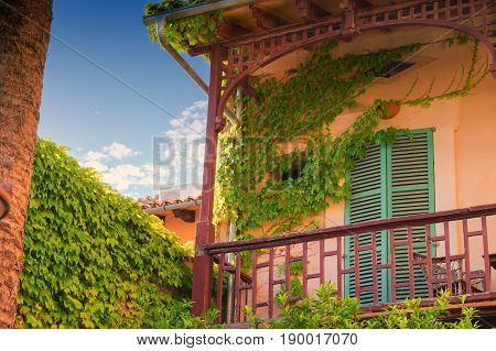 Buildings of colorful flowers surrounded in the village of Valldemossa on the island of Majorca in Spain.