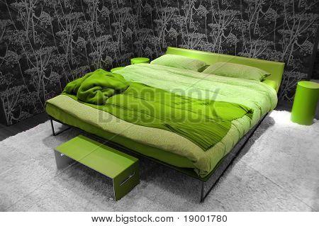 Dormitorio moderno verde natural
