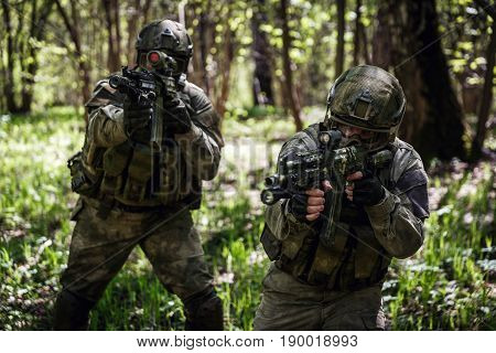Photo of officers on reconnaissance with machine guns