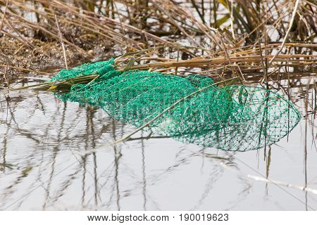 fishing with a net in the river .