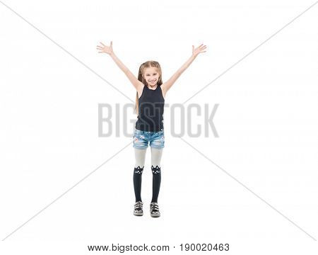 Adorable brunette teen girl in short shorts and tanktop raising hands and smiling widely