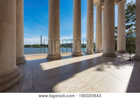 Sun shining through columns at the Jefferson Memorial in Washington DC