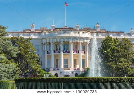 The White House in Washington DC with beautiful blue sky at summer day.
